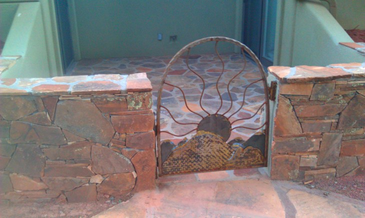 red rock wall and custom iron gate sedona contractor